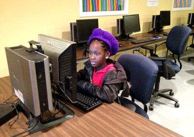A teenager takes advantage of Connecting for Good's technology center.