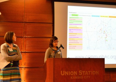 Ashley Sadowski (left) and Amanda Davis discuss CommunityKC, a tool built by Community Capital Foundation and the KC Brigade to let neighborhood leaders collaborate on community development projects.